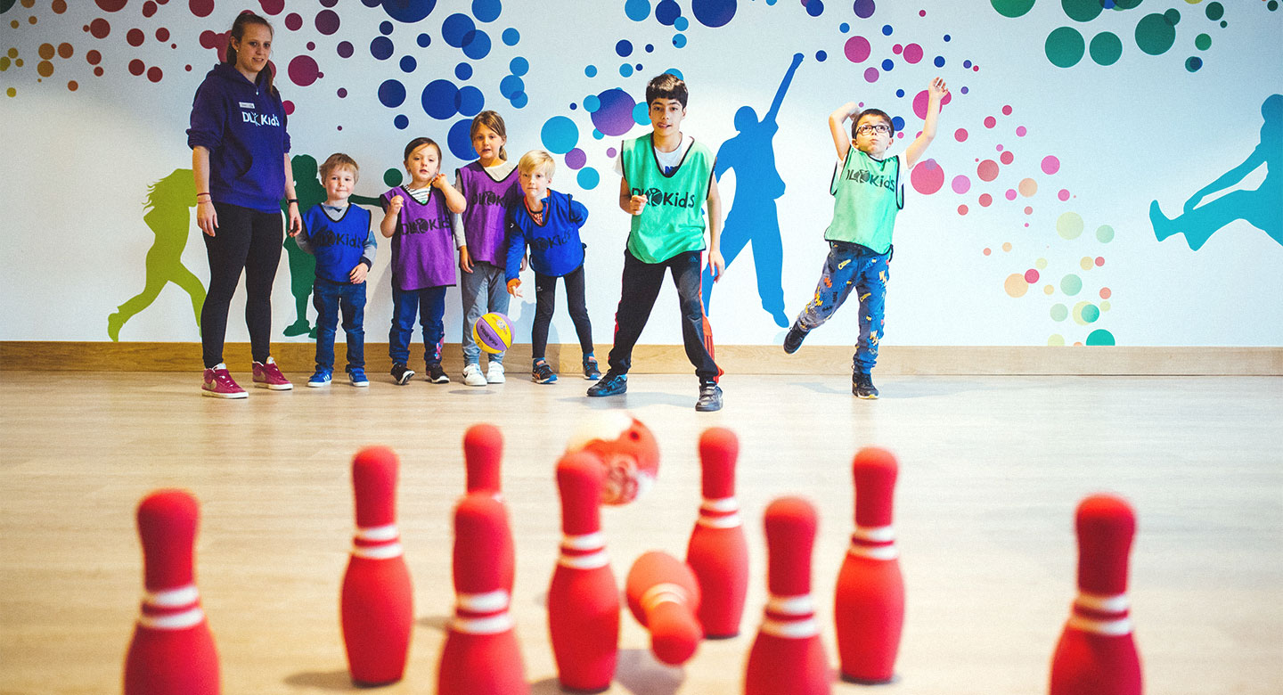 A group of Children Bowling.