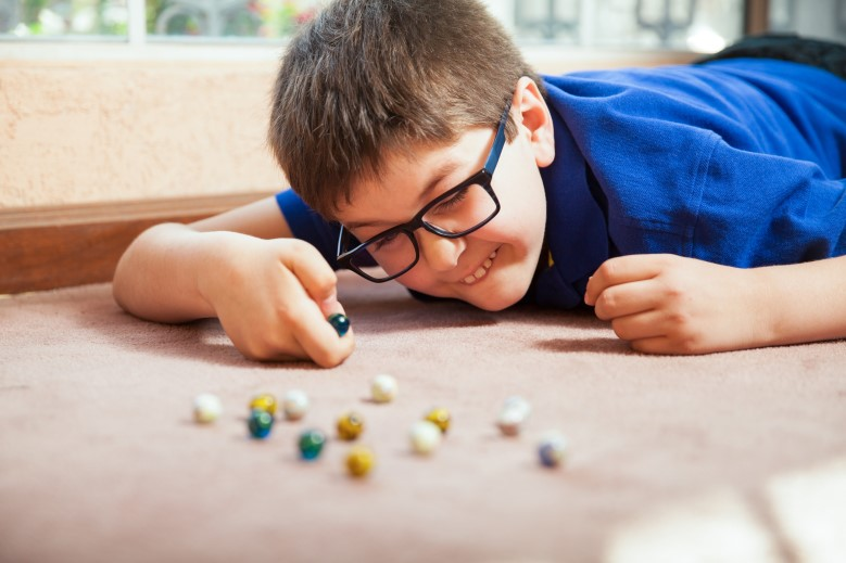 Boy with marbles