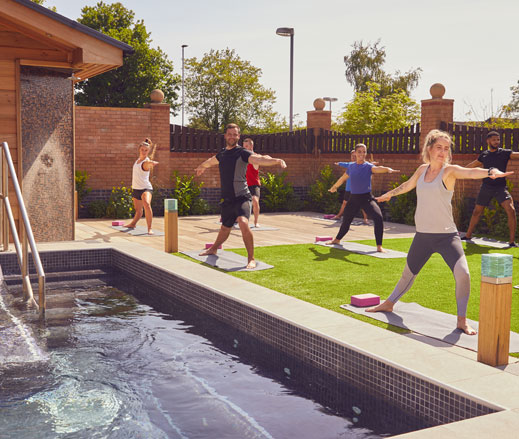 Image of outdoor yoga class at David Lloyd