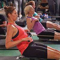 Group of people on the rowing machine.